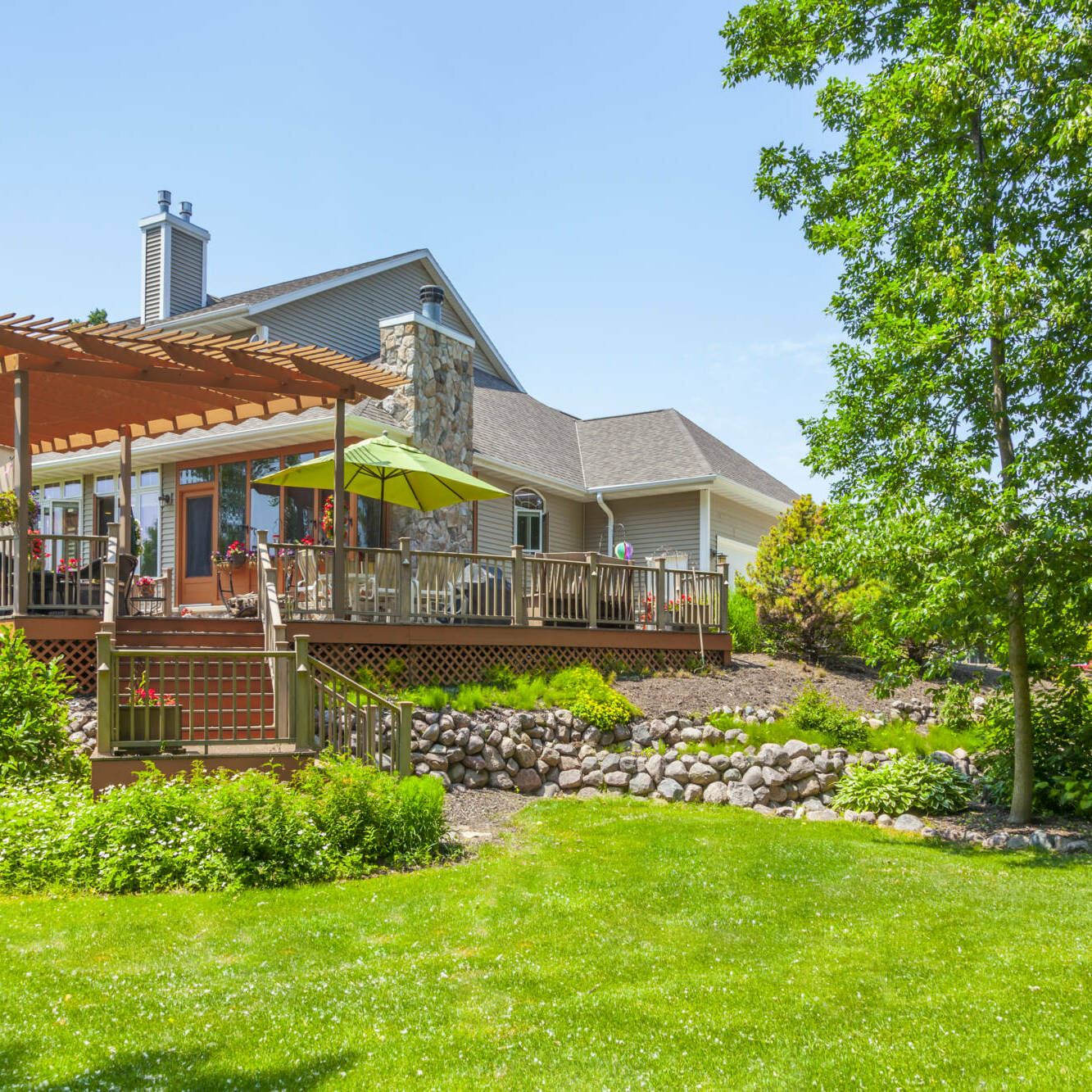 Beautiful Landscaped Yard and Deck with Pergola